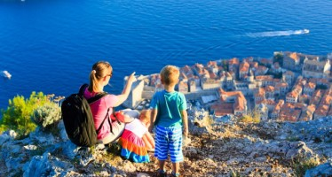 mother with kids looking at scenic view in Dubrovnik, Croatia